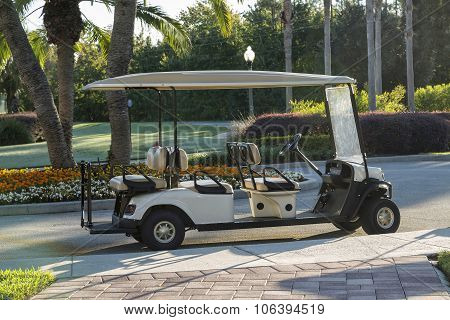 Empty Golf Cart Sitting On A Macadam Path By A Golf Course, Florida