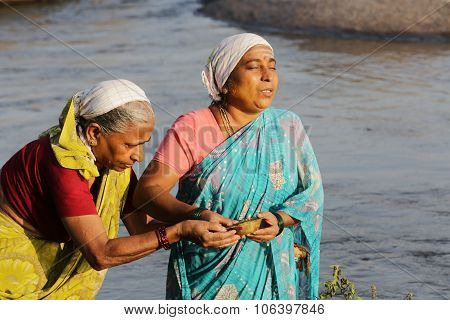HAMPI, INDIA - March 3:The Holy Women at the river during Sunday cleansing