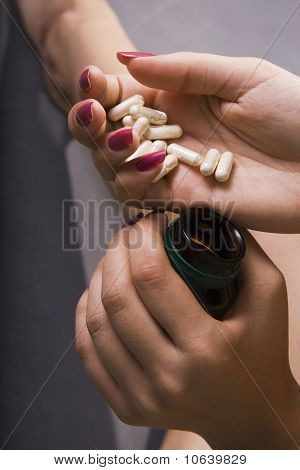 Young Woman Has Control Over Pills
