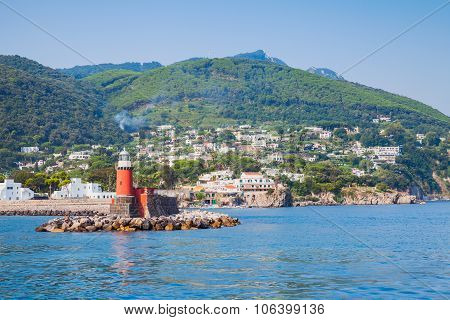 Red Lighthouse Tower On Stone Breakwater. Ischia