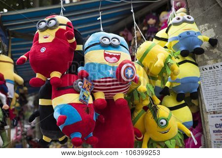 Colorful minions puppets hanging for sale