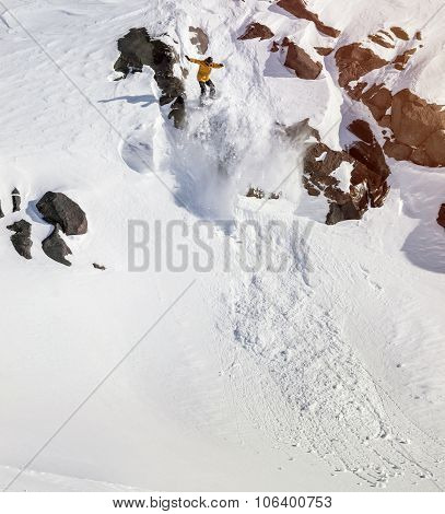 Snowboarder Moving Down In Mountains