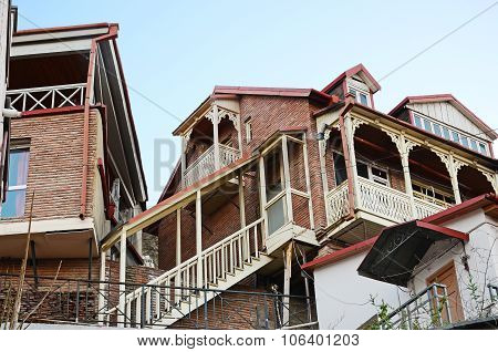 Tbilisian Traditional Houses With Wooden Carved Balcony And Staircase. Old Town