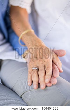 Wife Holding Hand Of Husband