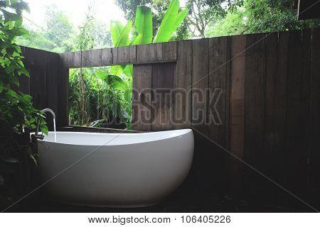 white bathtub in outdoor bath