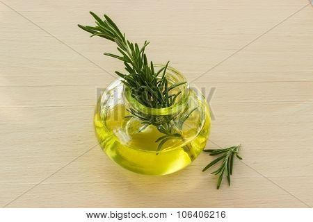 Rosemary With Essential Oil In A Glass Jar.