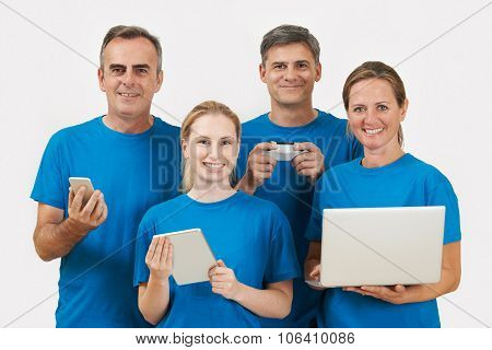 Studio Portrait Of It Support Staff Wearing Uniform Against White Background