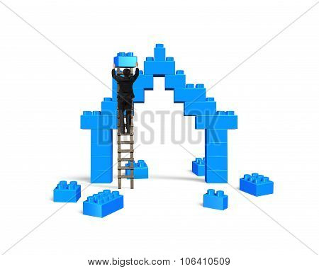 Businessman Climbing Ladder Completing House Shape Stack Blocks
