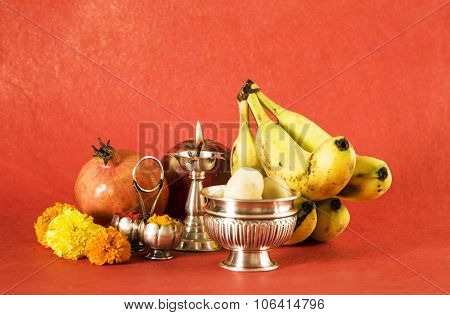 hindu puja elements, diya, haldi kumkum,apple, pomegranate and banana as offering to god and indian