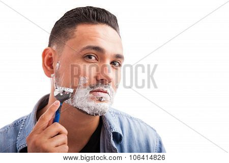 Hispanic Young Man Shaving His Beard