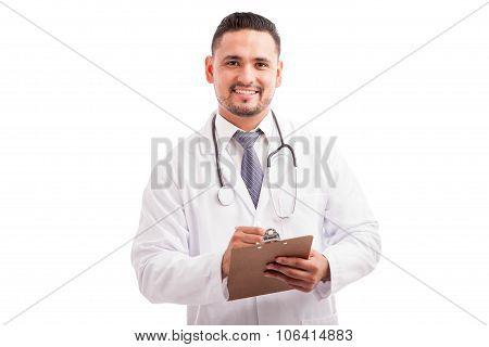 Attractive Doctor Writing A Prescription