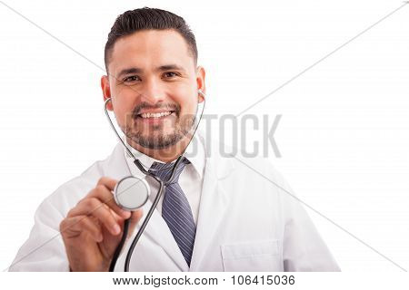 Happy Pediatrician Using A Stethoscope