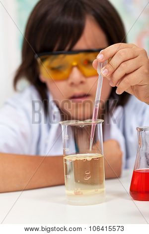 Elementary school boy doing the chemical yoyo experiment - closeup