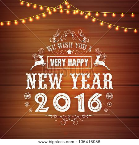 Creative greeting card design decorated with lights on stylish wooden background for Happy New Year 2016 celebration.