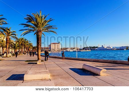Split, Croatia - October 1: Turists And Residents Walking Along The Sea Side In Historical Part Of S