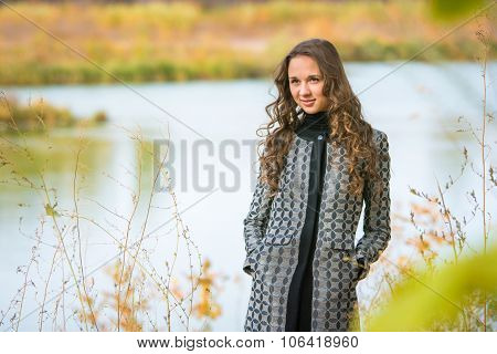 Portrait Of A Young Girl On A Background Of The Autumn River