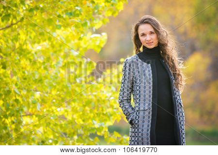 Cute Young Girl On The Background Of The Autumn Yellow Forests