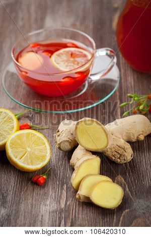 Tea with fresh goji berries and ginger