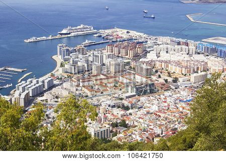 view of the city below, the ocean and the beach from the height of the Rock of Gibraltar