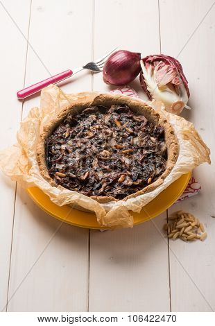cake with chicory onions and pine nuts