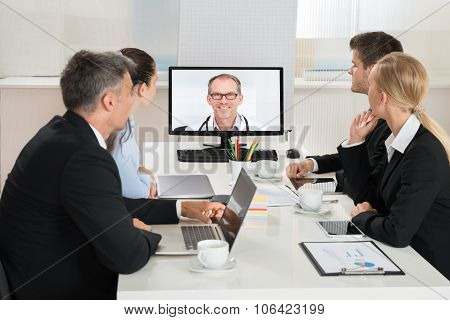 Businesspeople Videoconferencing With Doctors