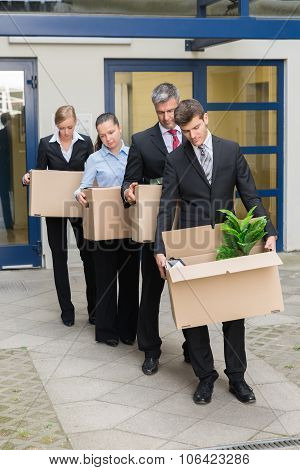 Disappointed Businesspeople With Cardboard Boxes