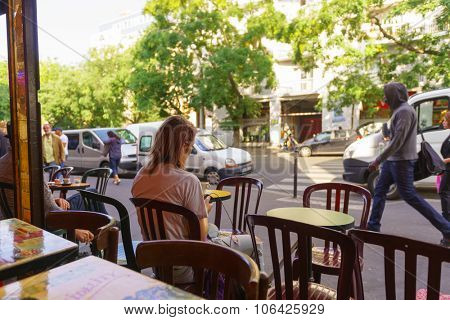 PARIS, FRANCE - AUGUST 10, 2015: view from cafe on streets of Paris. Paris is the capital and most-populous city of France. Situated on the Seine River, in the north of the country