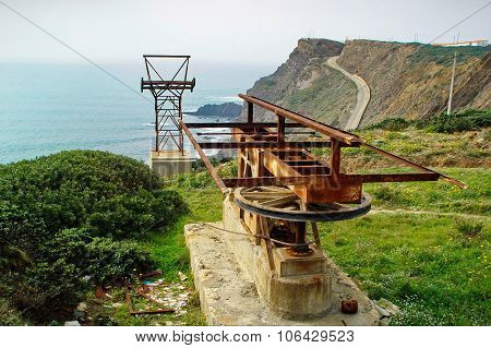 Rusty Winch Near A Cliff