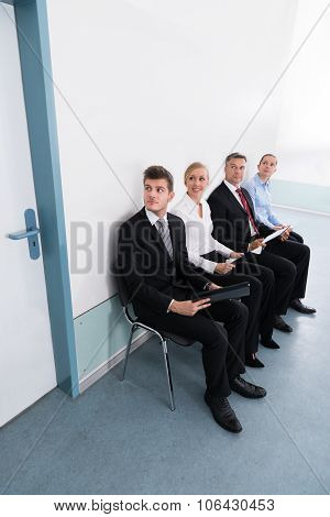 Applicants Sitting On Chair In Office