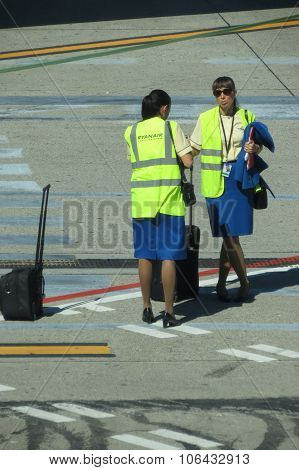 Aircraft Staff With Their Luggage At The Airport