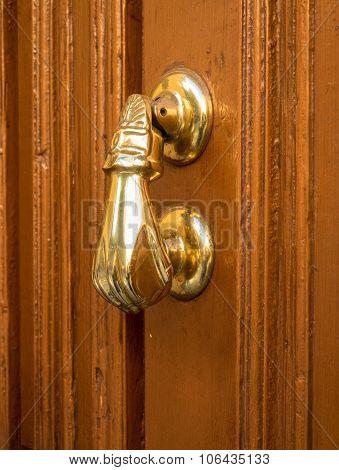 Detail Of Hand Shaped Door Knocker