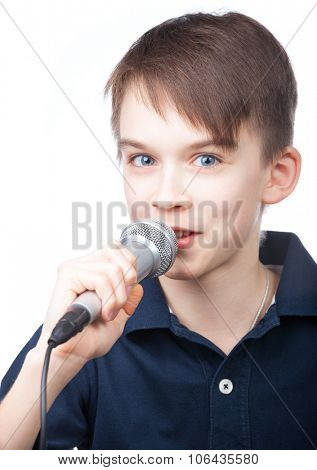 Cute boy wearing blue polo speaking to microphone on white background