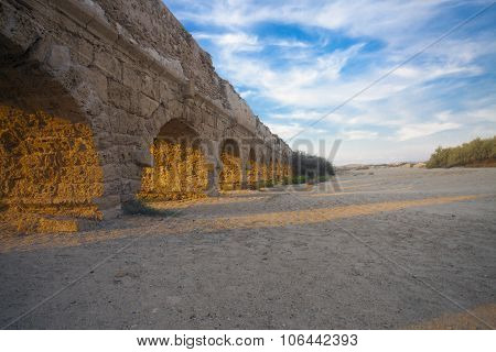 Sunset Rays Of Light On Aqueduct