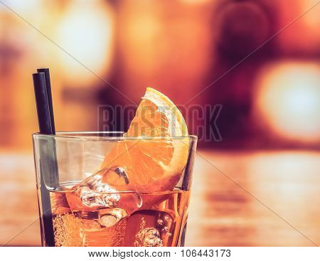 Detail Of Glass Of Spritz Aperitif Aperol Cocktail With Orange Slices And Ice Cubes On Bar Table, Vi