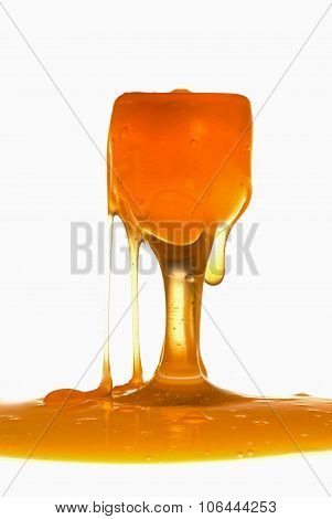 Thick liquid pouring from small ornate wine glasses