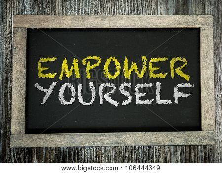 Empower Yourself written on chalkboard