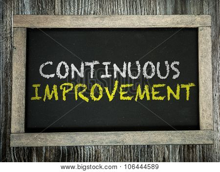 Continuos Improvement written on chalkboard