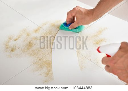 Male Janitor Cleaning Counter