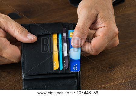 Businessman Showing Credit Card In Wallet