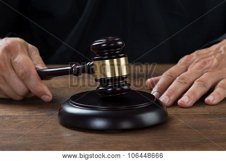 Judge Striking The Gavel At Table