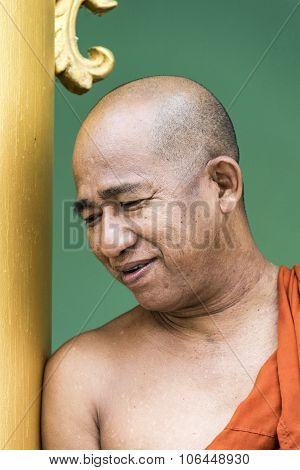Portrait Of Smiling Monk In Shwedagon Pagoda