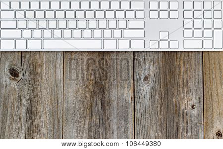 Computer Keyboard On Rustic Wooden Desktop