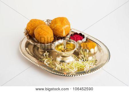 Beautifully Decorated Pooja Thali for diwali celebration to worship , having Indian sweets