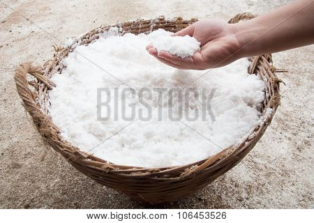 Hand With Salt In Basket