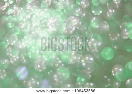 Holiday Abstract Green Glitter Defocused  Background With Blinking Stars