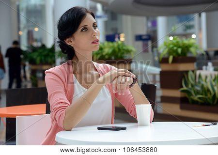 beautiful woman having a coffee-break