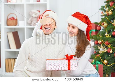 Christmas Gift. Woman Gives A Man Gift Present Box