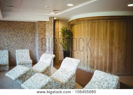 Multiple stone chairs in the sauna suite at the spa