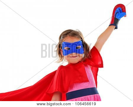Superhero little girl poses in boxing gloves isolated on white background