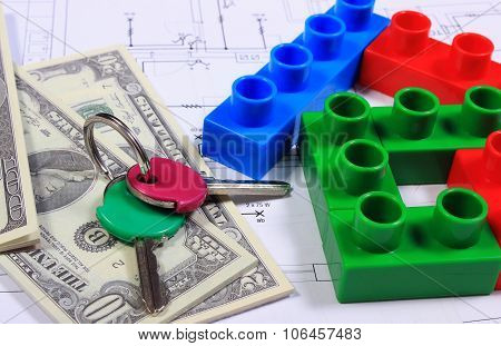 House Of Colorful Building Blocks, Keys And Banknotes On Drawing Of Home